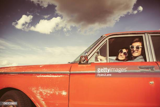 car ride couple retro - american culture stock pictures, royalty-free photos & images