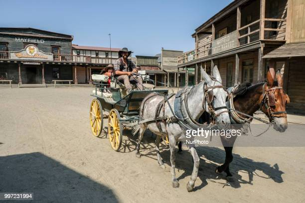 Car ride to visit the town The actors themselves do figurative work and customer service in Almeria Spain on 30 June 2018 Western films as mythical...