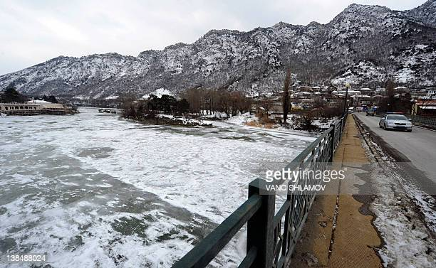A car rides on a bridge across the fozen Kura River in Mtskheta 25 km outside Tbilisi on February 7 2012 For the first time in at least 50 years the...