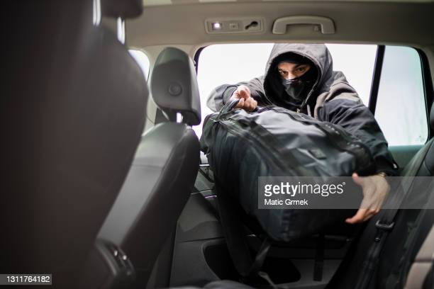 car robbery - hooligan stock pictures, royalty-free photos & images