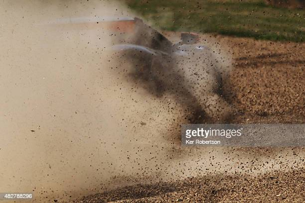 A car runs wide into the gravel at Clearways during the British GT Championship race at Brands Hatch on August 2 2015 in Longfield England