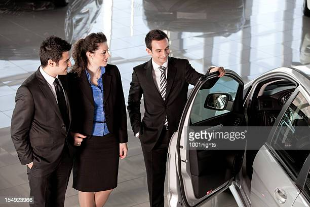 Car Salesman and Couple Buyer