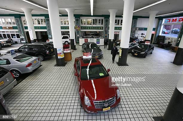Car salesman Bobby Sisk Jr walks through the showroom as he waits for customers at Ellis Brooks Chevrolet December 4 2008 in San Francisco California...