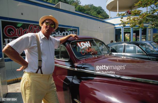 car salesman leaning against a vehicle - pigeon forge stock pictures, royalty-free photos & images
