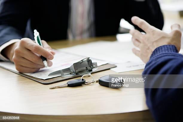Car Salesman with Client