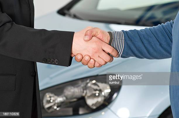 Car salesperson closing a deal