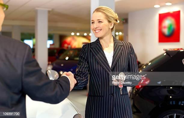 Car saleswoman selling car