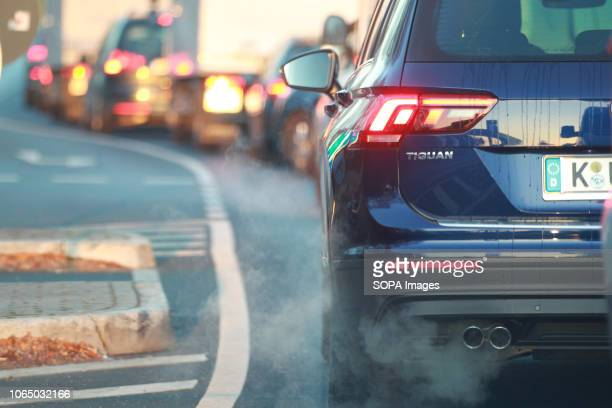 A car seen emitting exhaust fumes on the Street In Cologne A ban on diesel vehicles with Euro 4 engines or older engines as well as for petrol...