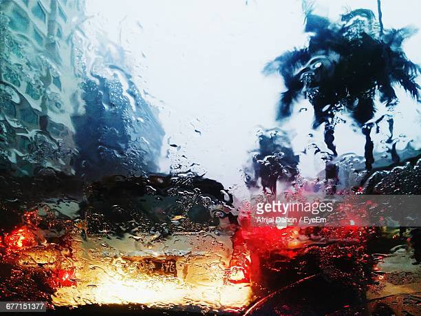 Car Seen Through Wet Windshield