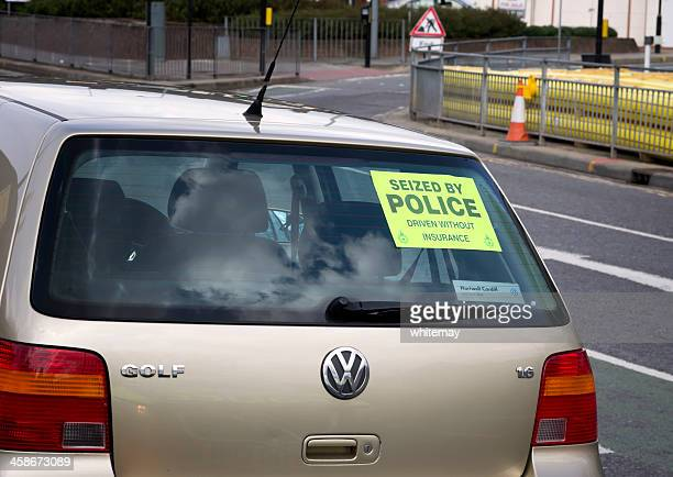 car seized by police, driven without insurance - shock tactics stock pictures, royalty-free photos & images