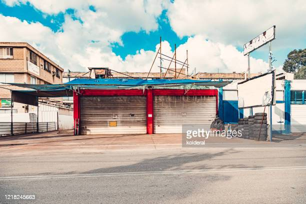 car service garage in industrial zone - auto repair shop exterior stock pictures, royalty-free photos & images