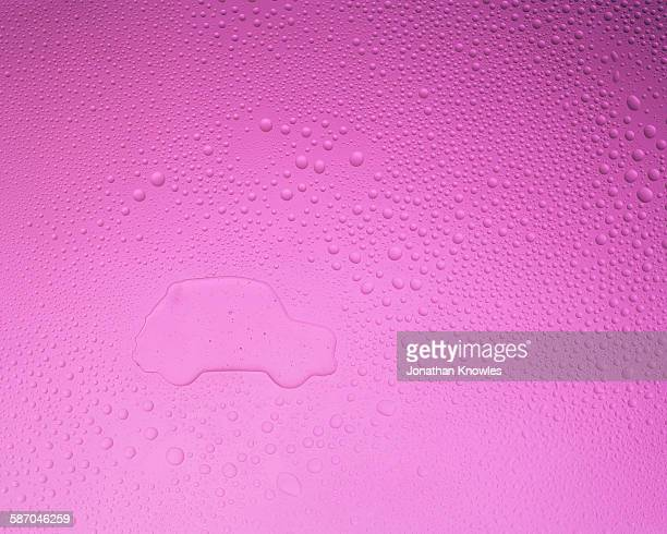 Car shape on pink background with condensation