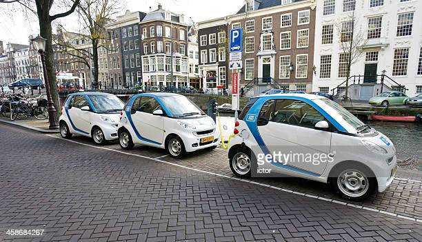 car share project of electric cars in amsterdam - smart car stock photos and pictures