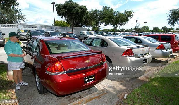 Car shopper Al Rubenstein of Lake Worth Florida examines the Maroone Chevrolet dealership price sticker of a Chevrolet Impala in Delray Beach Florida...