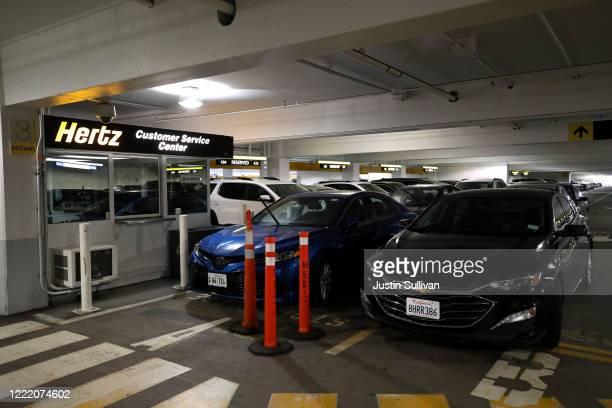 Car sit idle at the Hertz RentACar rental lot at San Francisco International Airport on April 30 2020 in San Francisco California According to a...
