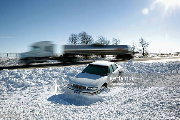 Car sits abandoned in the median of I-380 February 3, 2011 between Cedar Rapids and Iowa City, Iowa. A massive winter storm smashed into a third of...