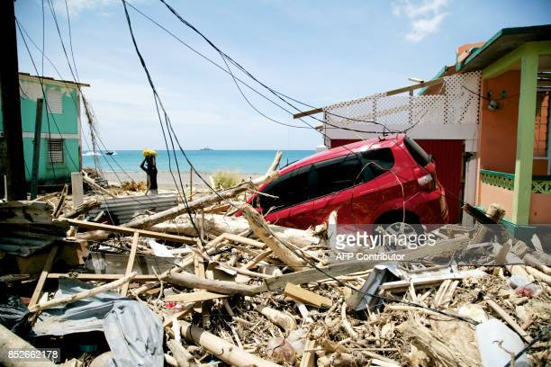 A car sits amid destruction on September 22 2017 in Roseau on the Caribbean island of Dominica following passage of Hurricane Maria Hurricane Maria...