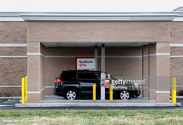 A car sits at the drive through automated teller machine of a KeyCorp bank branch in Streetsboro Ohio US on Friday Oct 30 2015 KeyCorp Ohio's...