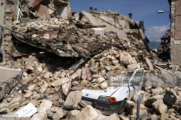 Car sits covered in rubble on April 7, 2009 in Onna a village near L'Aquila, Italy. On April 6, 2009 the 6.3 magnitude earthquake tore through...