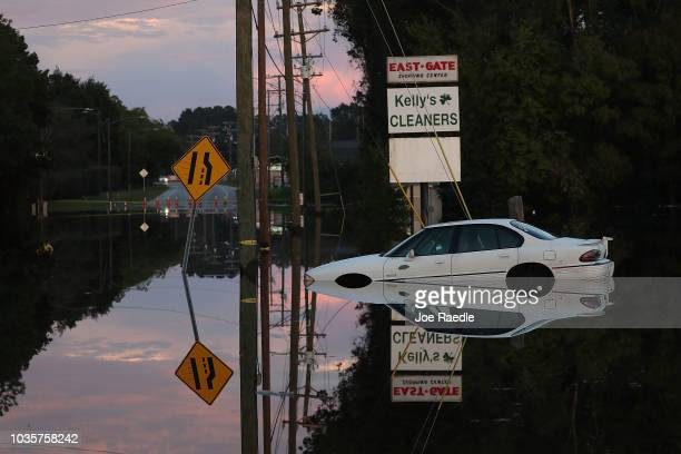 Car sits in a flooded parking lot on September 18, 2018 in Fayetteville, North Carolina. The Cape Fear river has reached its crest due to rains...
