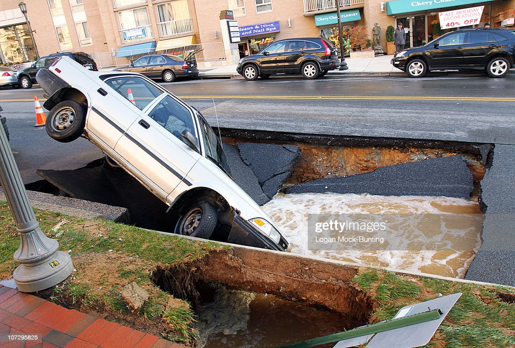 Sink Hole Swallows Car In Chevy Chase, Maryland : News Photo