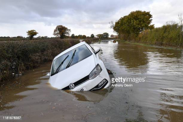 A car sits in flood water in the town of Fishlake near Doncaster after the river Don burst its banks on November 11 2019 in Doncaster England More...