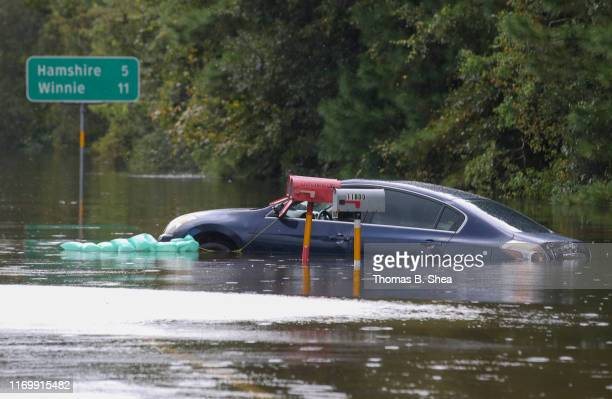 A car sits in the flooded waters on highway 124 on September 20 2019 in Beaumont Texas Gov Greg Abbott has declared much of Southeast Texas disaster...
