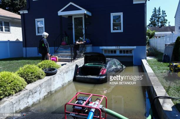 Car sits on a flooded garage of a house following a night of heavy wind and rain from the remnants of Hurricane Ida on September 02, 2021 in...