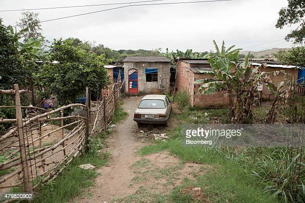 A car sits outside a home in the Dilma Rousseff favela of Rio de Janeiro Brazil on Monday July 6 2015 As the fastest inflation in more than a decade...