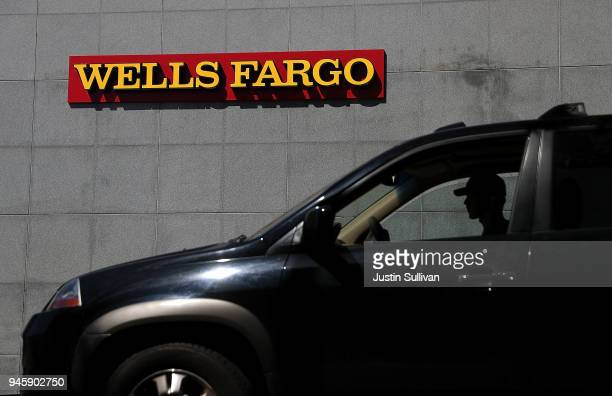 A car sits parked in front of a Wells Fargo bank office on April 13 2018 in San Rafael California Wells Fargo reported better than expected first...