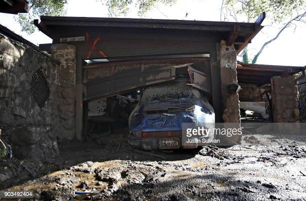 A car sits parked in the garage of a home that was damaged by a mudslide on January 10 2018 in Montecito California 15 people have died and hundreds...