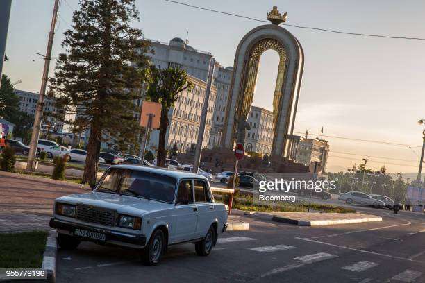 A car sits parked near the Statue of Ismoili Somoni in Dushanbe Tajikistan on Saturday April 21 2018 Flung into independence after the Soviet Union...