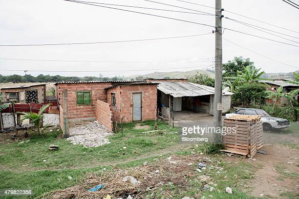 A car sits parked outside of a home in the Dilma Rousseff favela of Rio de Janeiro Brazil on Monday July 6 2015 As the fastest inflation in more than...