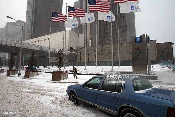 A car sits stalled out in front of the General Motors Corp in heavy snow December 19 2008 in Detroit Michigan President Bush announced Friday that...