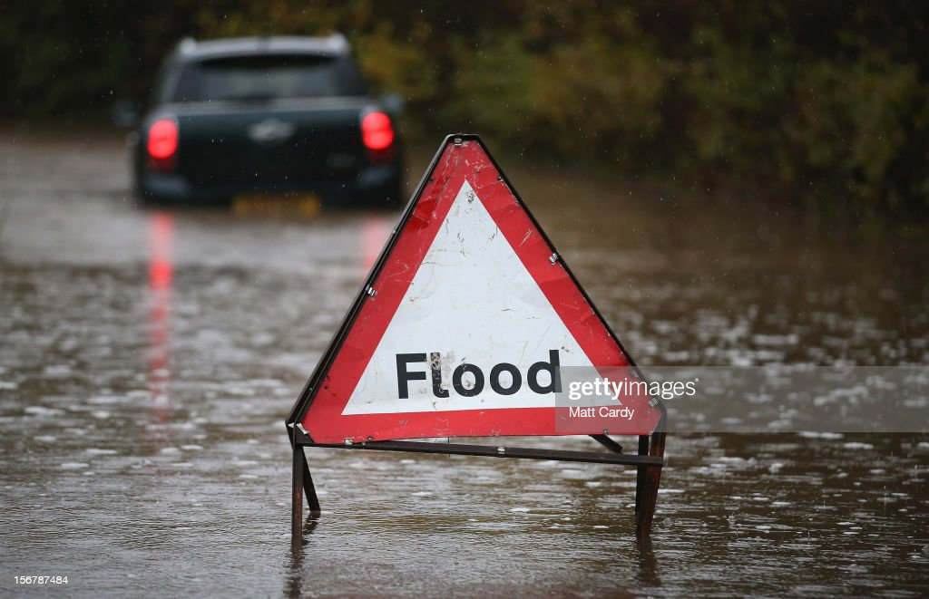 A car sits stuck in flood water on a lane in the village of Chilcompton on November 21, 2012 near Wells, England. Heavy rain overnight has brought widespread disruption to many parts of the UK particularly in Somerset and Wiltshire and weather forecasters have warned of more wet and windy weather to come.