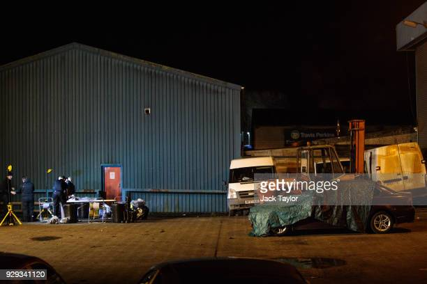 BMW car sits under tarpaulin on an industrial site during police investigations into the poisoning of Sergei Skripal in Salisbury who was found...