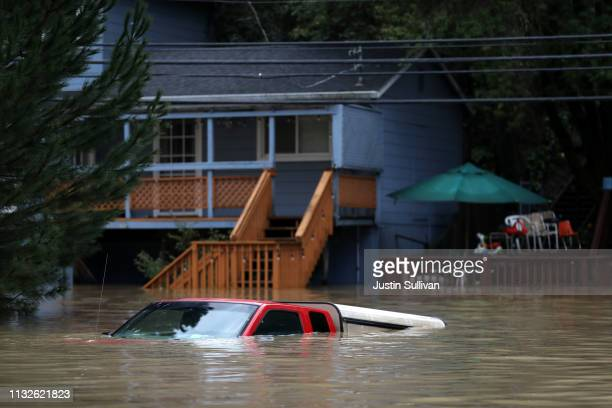 A car sits underwater in a flooded neighborhood on February 27 2019 in Forestville California The Russian River has crested over flood stage and is...