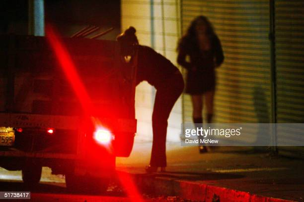 "Car slows down for two female police officers posing as prostitutes on Holt Boulevard, known to sex workers throughout southern California as ""the..."