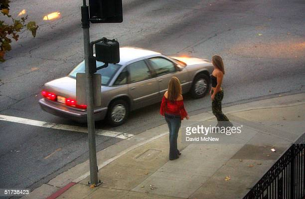 A car slows down for two female police officers posing as prostitutes on Holt Boulevard known to sex workers throughout southern California as 'the...