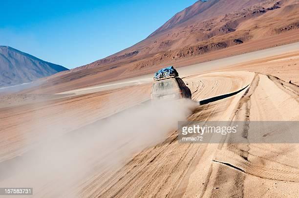 SUV Car Speeding In The Bolivian Desert