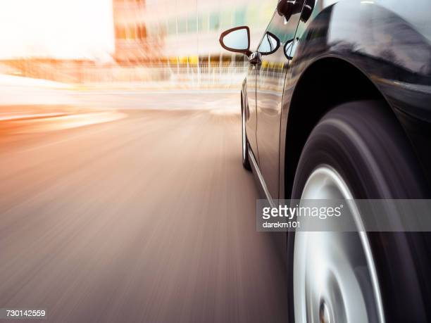 Car speeding towards an office, Illinois, America, USA