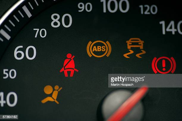 car speedometer with illuminated seat belt sign - dashboard stock pictures, royalty-free photos & images