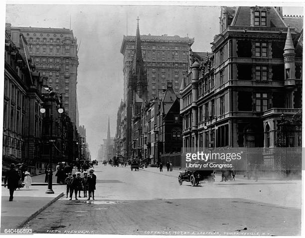 A car speeds down Fifth Avenue kicking up dust from the dirt street ca 1907 New York City