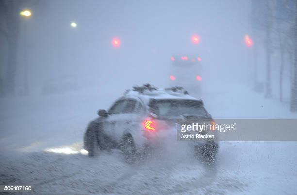 A car spins out of control on Central Park West Avenue and West 81 street during heavy snow fall on January 23 2016 in New York City A major...