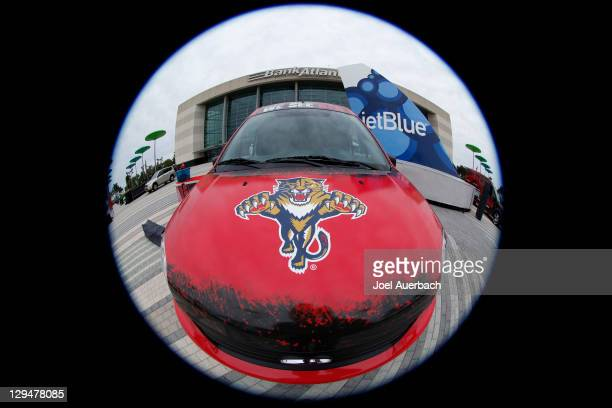 A car sporting the new 'We See Red' slogan on the front window in front of the BankAtlantic Center prior to the season home opener between the...
