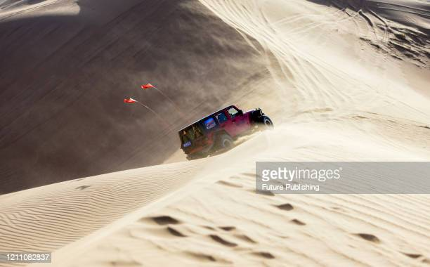 Car sports enthusiasts drive in Alashan dream desert car aviation park. Inner Mongolia, China, April 26, 2020. Located in the hinterland of Tengger...