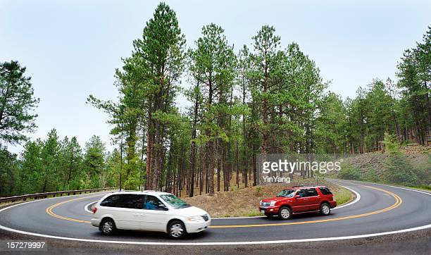 Car, Sports Utility Vehicle Driving Around Mountain Road Hairpin Curve