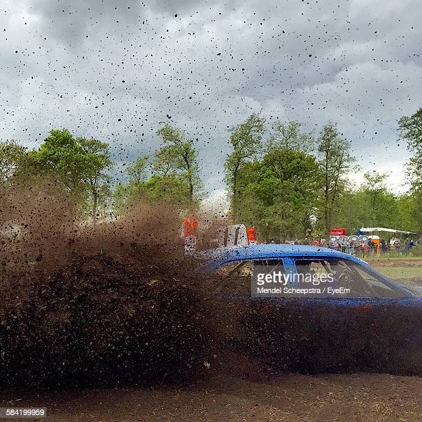 car spraying dirt against sky - rally car racing stock pictures, royalty-free photos & images