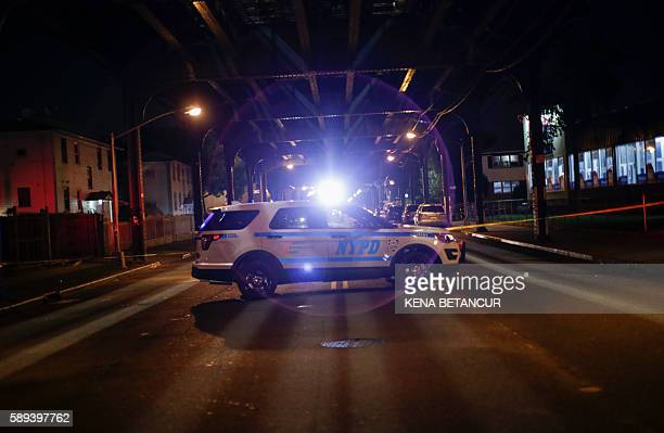 A NYPD car stand on the crime scene in Ozone Park after where Mosque leader Maulama Akonjee and friend Thara Uddin were killed in the Queens borough...