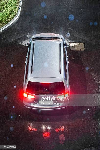Car standing on street in rain, elevated view